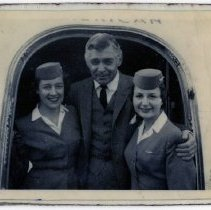 Image of Clark Gable and Two Delta Stewardesses