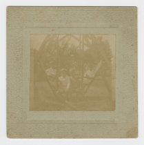 Image of 1986.9.47 - Booker children on yard swing
