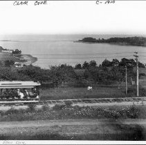 Image of Trolley headed south through Clam Cove in Rockport