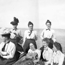 Image of Grace Parker (seated sideways) at Northport with friends, 1900