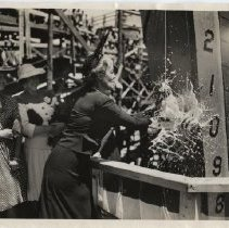 """Image of Senator Margaret Chase Smith christens the barge """"Pine Tree III""""  in Camden"""
