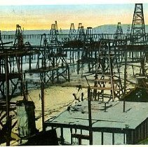 Image of Oil wells by the sea, California