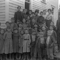 Image of GP4/5.153 - REMARKS:School Group, Camas Valley. teacher (R) Elmer Clayton, Girl Second from Left - Pearl Carter