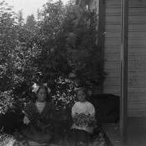 Image of GP4/5.158 - REMARKS:Two unidentified girls sitting with a bouquet of flowers in their laps.
