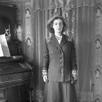 Image of GP4/5.246 - REMARKS:Lillian Kirkendall in suit with lace on cuffs and collar, lace curtains