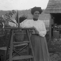 Image of GP4/5.253 - REMARKS:Estelle Belueu in farm yard with potted flowers