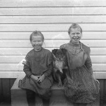 """Image of GP4/5.373 - REMARKS:Two young girls and a dog, Glendale, OR, area, May 27, 1906. On the original photographers envelope was """"Johnson girls"""".  OBJECT DATE:May 27, 1906"""