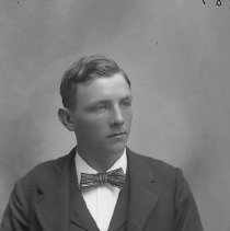 Image of GP4/5.424 - REMARKS:Studio portrait of a young man wearing a suit.