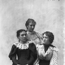 Image of GP4/5.465 - REMARKS:Studio portrait of three young women wearing dresses with wide lace collars, puffed or leg-o-mutton sleeves.