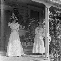 Image of GP4/5.742 - REMARKS:Two young women in ornate hats standing on a porch.  OBJECT DATE:ca. 1890