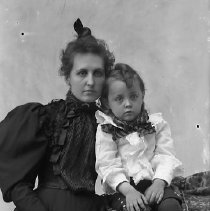 Image of GP4/5.770 - REMARKS:Studio portrait of a young woman and a small boy.