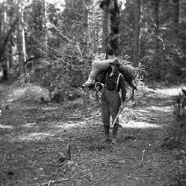 Image of Deer hunter with game ca 1920