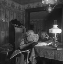 Image of GP4/5.97 - REMARKS:Mr. & Mrs. M. L. Brown reading out of the Bible. Douglas County ca. 1920.