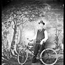 Image of GP4/5.8 - REMARKS:Unidentified man with bicycle; studio photograph