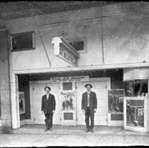 Image of GP4/6.24 - REMARKS:Exterior view, Roseburg theater, showing two men, ca 1911.