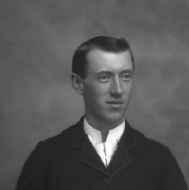 Image of GP5/7.1163 - REMARKS:Studio portrait of a young man in a suit with piping around the collar and coat.  OBJECT DATE:ca. 1890