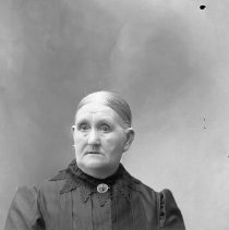 Image of GP5/7.516 - REMARKS:Studio portrait of older woman. She wears a lace collar and large brooch. Her hair is combed straight back.  OBJECT DATE:ca. 1890
