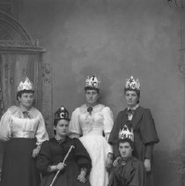 "Image of GP5/7.672 - REMARKS:Studio portrait of five young women who appear to belong to a society. All wear crowns decorated with stars and crosses. One woman carries a scepter and another has a crown that says""Beauty"".