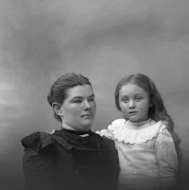 Image of GP5/7.689 - REMARKS:Studio portrait of a young woman and child. Little girl has long curly hair.