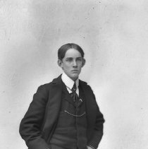 Image of GP5/7.740 - REMARKS:Studio portrait of a young man in preceding photo. He is standing. He wears a three-piece suit with a watch chain across his vest. (See GP5/7.739).