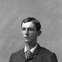 Image of GP5/7.746 - REMARKS:Studio portrait of a young man wearing a three-piece suit, tie pin and long watch chain with fob.  OBJECT DATE:ca. 1890