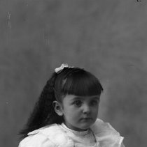 Image of GP5/7.755 - REMARKS:Studio portrait of a small girl with long curly hair.  OBJECT DATE:ca. 1890