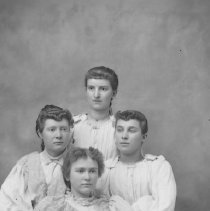 Image of GP5/7.841 - REMARKS:Studio portrait of four young girls. All have curls and wear blouses with large puffed sleeves.  OBJECT DATE:ca. 1890