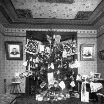 Image of GP8/10.45 - REMARKS:Christmas tree and gifts in parlor, Oakland, OR? Ornate wallpaper of the 1890's.