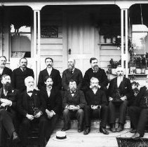 Image of GP8/10.71 - REMARKS:Oakland business men in front of Graves Studio, ca 1895. Back row LtoR: Unident; Al Dear; Unident.; Unident; Dr. E.J. Page. Front: Chas. Sehlbrede; Prof. Geo. T. Russell; Unident; Mr. Sacry; Unident.; Unident.; Unident.  OBJECT DATE:ca 1890's