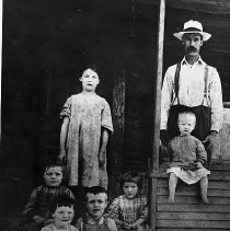 Image of N10228 - REMARKS:The Holtzclaw Family at Glendale, Oregon, ca. 1910. William (standing); Earl (on the porch rail); Nell; Lora and George Holtzclaw; and Carry Oakes.  OBJECT DATE:ca. 1910