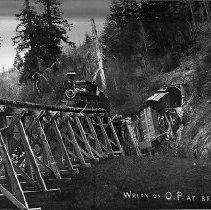 Image of N10368 - REMARKS:A wreck on the Corvallis and Eastern Railroad on Bridge 24, Tunnel 1, in 1897. The engine is Central Pacific Railroad No. 2 (4-4-0 type) built by Rogers Locomotive Works. The bridge over Yaquina River collapse at the west portal of the tunnel, between Trapps and Morrisons.