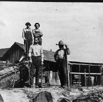 Image of N10452 - REMARKS:Billy Vincent's Sawmill, now Joelson Road, near Umpqua, four men in view.