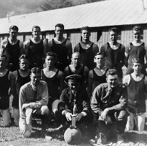 """Image of N10721 - REMARKS:Camp Tyee basketball champions - group was Douglas County champions, Eugene District Champions, Oregon State CCC champions. In front row the captain, """"The Skipper"""" with trophy and a doctor."""