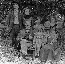 Image of N10858 - REMARKS:Olinghouse family. Rear row, left to right: John Barney, Violet, Lieuretta, James Binger and Sarah Elizabeth. Front row seated, left to right: James Cyrus Olinghouse, Jennie Ettabelle and Sarah Elizabeth Horner Olinghouse.