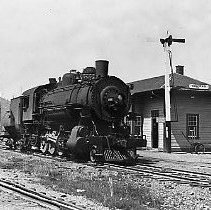 Image of N10882 - REMARKS:Southern Pacific 2-8-0 engine #2825 at the depot at Cochran, Oregon.