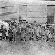 Image of N10962 - REMARKS:North Deer Creek school, shows school house, Hattie Rose teacher at left and students in 1912.