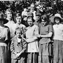 "Image of N11677 - REMARKS:Group of Elkton people, rear, left to right: ""Polk"" Henry Traylor; unident.; Una Henderer; Geroge Binder (Top); Kenneth Grubbe. Front row: Hattie Grubbe; Wilma Wakefield; Lorie Wakefield; Jennette Helms; Vida Higginbotham [spelling corrected by family genealogist, 1996]. This view was taken across the street from the Cash Market, ca. 1917.