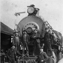 Image of N12232 - REMARKS:Engine No. 2587 at the Glendale Railroad Depot, ca. 1898. The man at far left in the background is Josiah Jones, the dray man until 1920, and at far right is R.K. Montgomery, the station agent.  OBJECT DATE:ca. 1898