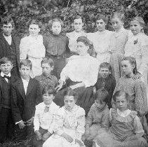 Image of N12243 - REMARKS:A Walker School group located on the Walker property west of Elkton on Henderer Road. Back row (left to right): Rollie Letsom; Addie Hurd; Lillie Hargan; Eliza Henderer; Audrey Walkr; Edith Brown; Mabel Hargan. Second row: Charley Hurd; Herbert Brown; Charley Henderer; Edith Moon (teacher); Bert Hurd; Carrie Henderer. Front row: Archie Hurd; Mabel Henderer; Mattie Brown; Flossie Letsom. 1906.