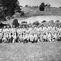 Image of N12246 - REMARKS:The Oregon Guard on the Elkton High School field during WWII, 1942 or 1943.