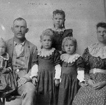 Image of N12340 - REMARKS:Leona Matthews (Hill) at age 8 with her family. Left to right: Roy; Mr. Matthews; Gertrude; Leona; Cloy; Mrs. Matthews. 1893.