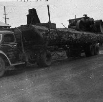 Image of N12356 - REMARKS:A Roseburg Lumber Company truck, 1940. It is loaded with logs for Mt. Scott, parked on E. Second Ave. (Diamond Lake Blvd.), Roseburg, Oregon.