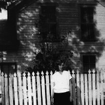 Image of N12357 - REMARKS:Ethel Krohn on the Krohn-Woodruff Farm. The south exposure of the house showing a picket fence.