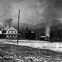 Image of N12361 - REMARKS:A view of Glendale, Oregon, in the snow. A good view of the Clarke Hotel (at left) and the depot (at right). A postcard view.