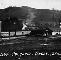 Image of N12391 - REMARKS:The Southern Pacific depot and yards in Drain, Oregon. A postcard view.