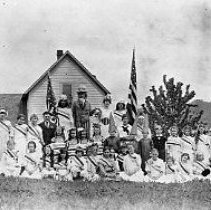 Image of N12399 - REMARKS:A large group of people in costume for the Memorial Day program for the Civil War Veterans of Yoncalla, 1914. Yoncalla School is in the background.