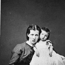 Image of N12478 - REMARKS:Mrs. Isabelle Applegate holding her son Harry.