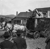 Image of N1282 - REMARKS:Circus parade, Jackson St. at Cass St., Roseburg. Norris and Rowe's Circus, May 16, 1904. Horses pulling cage wagon with lion.  OBJECT DATE:May 16, 1904