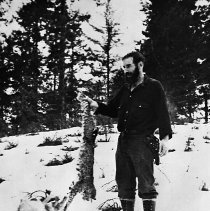 Image of N12959 - REMARKS:Perry Wright holding dead cougar, ca. 1940s. North Umpqua area.  OBJECT DATE:ca. 1940s