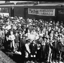 Image of N12963 - REMARKS:Farming Demonstration train at Yoncalla, Or. Southern Pacific line. Shows large crowd. ca. 1920s.  OBJECT DATE:ca. 1920s